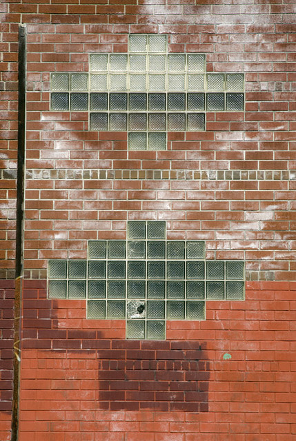 Art deco glass bricks on a brick wall in gowanus brooklyn - Glass bricks designs walls ...