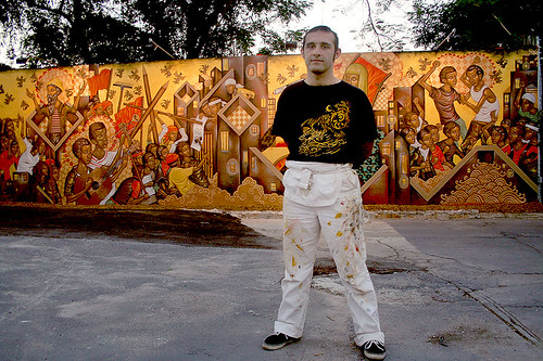 Stelios Faitakis in front of his mural at Wynwood Walls, Miami