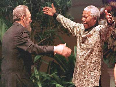 Commandante Fidel Castro greets President Nelson Mandela of South Africa when the socialist leader addressed the South African parliament in the late 1990s. by Pan-African News Wire File Photos