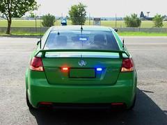 wheel(0.0), automobile(1.0), automotive exterior(1.0), vehicle(1.0), compact car(1.0), pontiac g8(1.0), sedan(1.0), land vehicle(1.0),