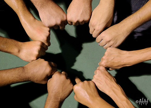 unified circle of hands by Flickr user 3ammo, creative commons