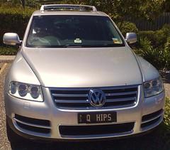 wheel(0.0), automobile(1.0), automotive exterior(1.0), sport utility vehicle(1.0), volkswagen(1.0), vehicle(1.0), volkswagen touareg(1.0), bumper(1.0), land vehicle(1.0), luxury vehicle(1.0), vehicle registration plate(1.0),