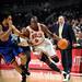 Luol Deng attacks the basket