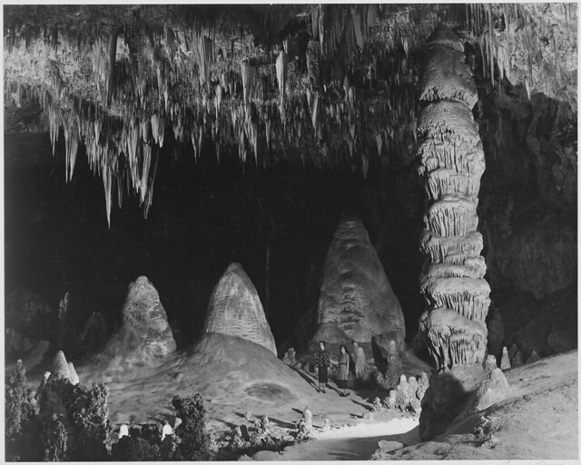"""""""Two people in background, 'The Rock of Ages in the Big Room,' Carlsbad Caverns National Park,"""" New Mexico."""
