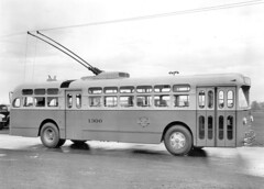 double-decker bus(0.0), tour bus service(0.0), flxible new look bus(0.0), trolleybus(1.0), vehicle(1.0), transport(1.0), mode of transport(1.0), public transport(1.0), monochrome photography(1.0), land vehicle(1.0), monochrome(1.0), black-and-white(1.0), bus(1.0),
