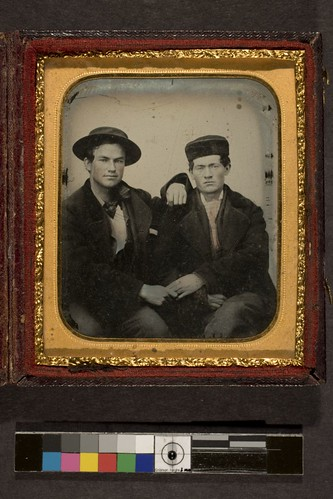 Portrait of two men holding hands