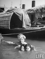 Saigon 1950 - Mother and her two children taking a bath in the Saigon river