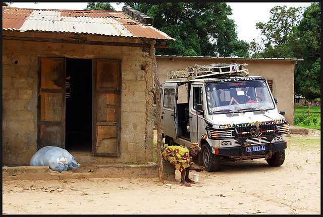 Senegal Woman and Mercedes, in Africa