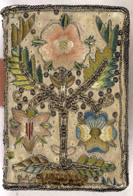 17th century embroidered satin book with floral motif.