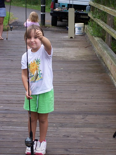 My daughter (then a precocious 5-year-old, now a surly teen) and her first fish caught at College Run Creek during a children's fishing tourney!
