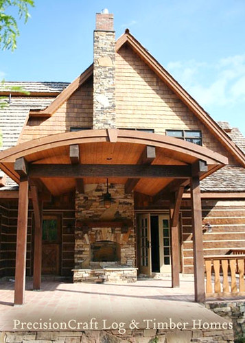 Covered deck outdoor fireplace hybrid log timber hom for Log home decks