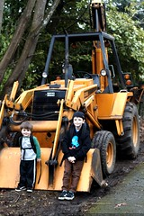 brothers posing with a backhoe in our neighborhood