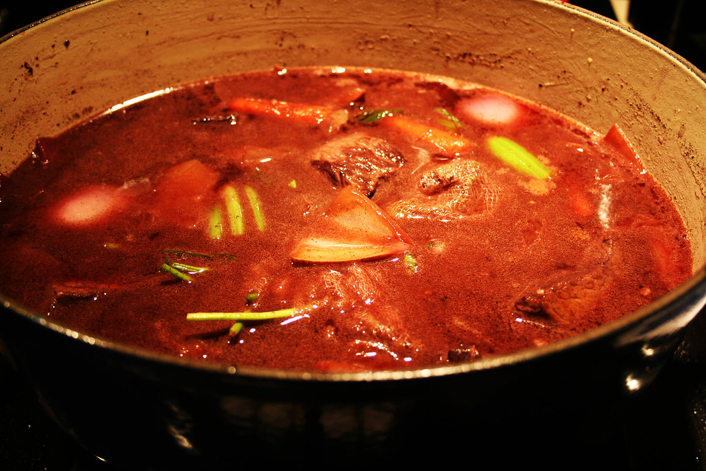 simmering the vegetables and beef