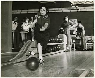 Woman bowling, circa 1950