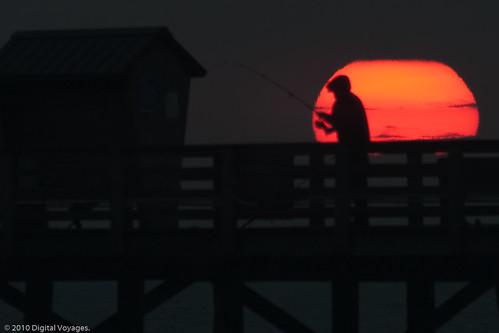 ocean morning light sea sky sun man beach silhouette sunrise dawn pier twilight fishing florida horizon f5 flagler fishingpole flaglerbeach ©jhinukchowdhury