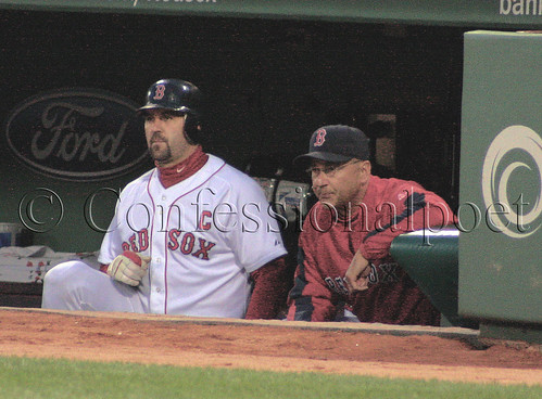 Tek and Tito watch from the dugout