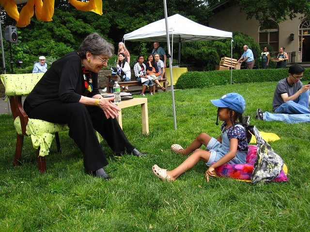 Children's Poet Laureate Mary Ann Hoberman meets a fan in the Fragrance Garden during Bee-Day. Photo by Rebecca Bullene.