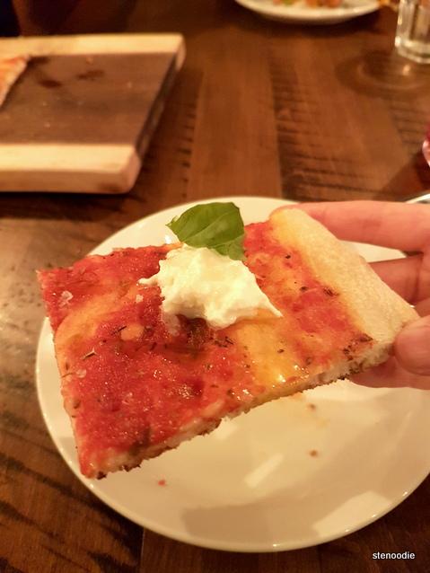 Burratina pizza slice