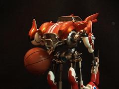 iron man(0.0), macro photography(0.0), machine(1.0), red(1.0), mecha(1.0), toy(1.0),