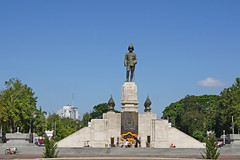 Statue of King Rama VI at the entrance to Lumphini Park near Silom in Bangkok, Thailand