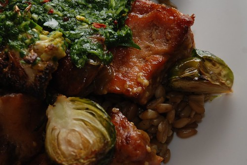 roasted pork shoulder with chimichurri, brussel sprouts, and cauliflower