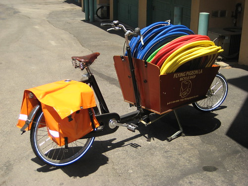Colorful, but cheap, tires being delivered in a Workcycles Bakfiets
