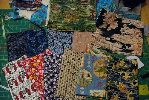 Half of the fabrics Alice picked up for me at Dragon Mama in Hilo, Hawaii.  Hooray for Japanese and Chinese fabrics you can't easily find on the mainland!   See the entry on my site:  domesticat.net/2010/01/previews-2010-new-years-fabric