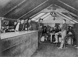Men gathered for a drink in the Road House Saloon, Bluff City, Alaska