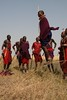 Kamunu Saitoti, winner of the 'Most Improved Lion Guardian' award, is shown here jumping to celebrate the Games. In the Maasai culture, it is traditional for men to engage in this competitive jumping activity, which is used to show the murrans, or warriors', stamina and strength...and to impress the girls! Kamunu is showing how high he can jump and having a great time in the process.   Learn more about the joint Panthera/Living with Lions Lion Guardians program at www.panthera.org/programs/lion/lion-guardians  © Kylie McQualter