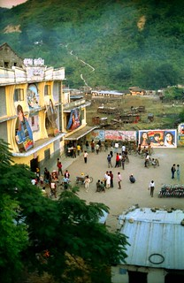 Indian Movie Posters on a large Movie Theater, people, Street view of an border town in Nepal near Lumbini, Southern Nepal, near India, 1993