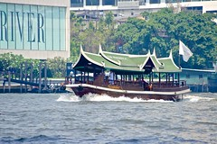 Shuttle boat of the Peninsula hotel on the Chao Phraya river in Bangkok, Thailand