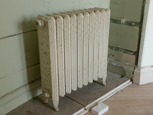 An ornate cast iron radiator