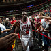 Luol Deng celebrates with the crowd after his career performance