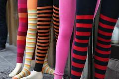 footwear(0.0), trousers(0.0), sock(0.0), thigh(0.0), pattern(1.0), textile(1.0), clothing(1.0), red(1.0), leggings(1.0), limb(1.0), leg(1.0), design(1.0), pink(1.0), tights(1.0),