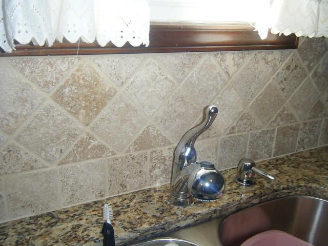 Santa Cecilia Granite Countertops With Tile Backsplash In