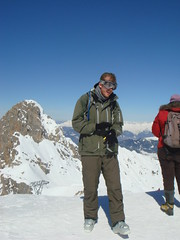 snowshoe(0.0), ski touring(0.0), extreme sport(0.0), nordic skiing(0.0), adventure(1.0), footwear(1.0), mountain(1.0), winter(1.0), walking(1.0), recreation(1.0), snow(1.0), outdoor recreation(1.0), mountaineering(1.0), mountain range(1.0), summit(1.0), ridge(1.0), mountainous landforms(1.0),