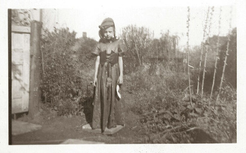 Young gIrl in long dress and hat and braids