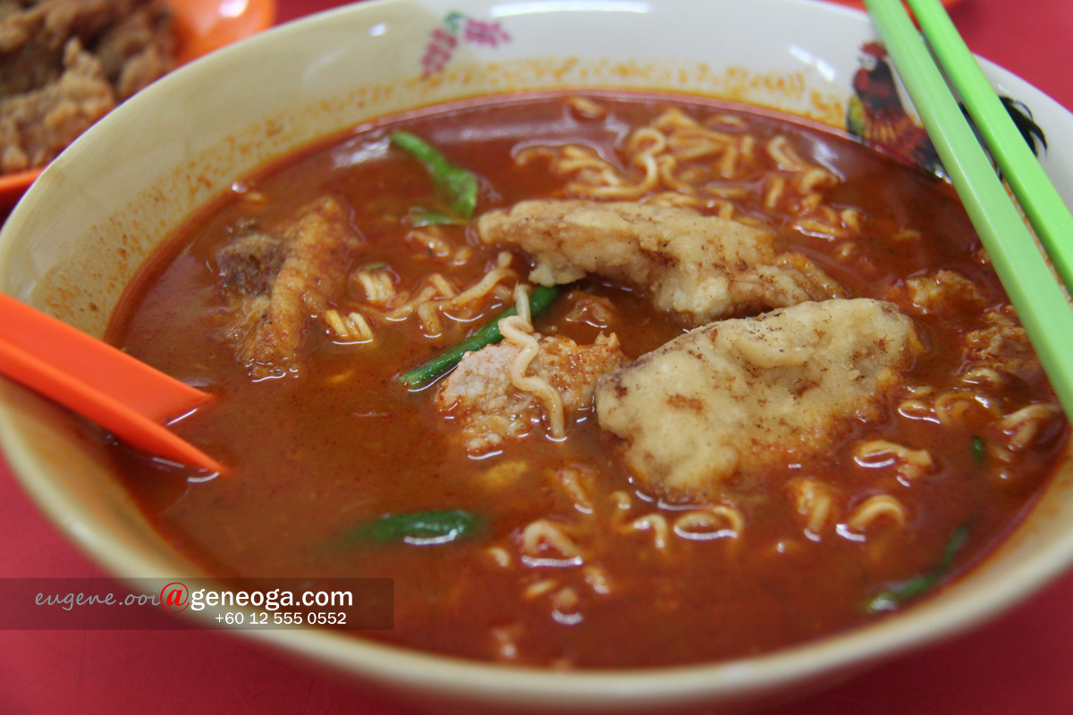 Tom yum soup instant noodle with fried fish