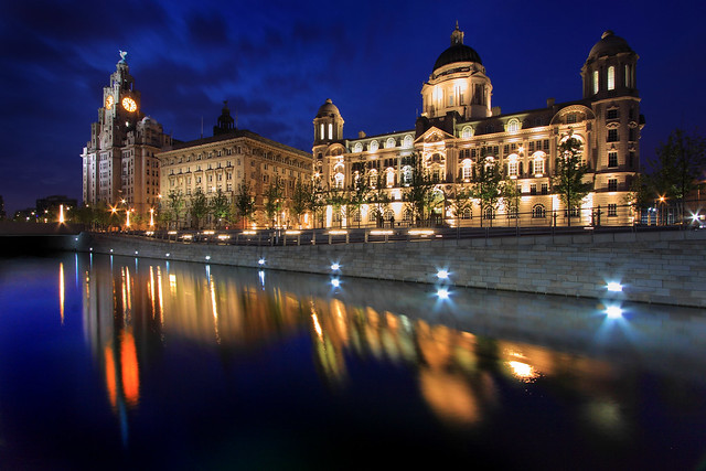 Reflections of the Three Graces Liverpool pier head.