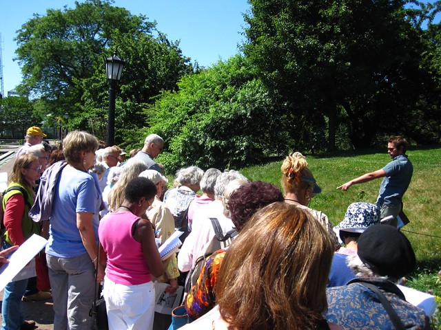 BBG Garden guides gather to learn about the recently planted Annual Border display from curator Cayleb Long.
