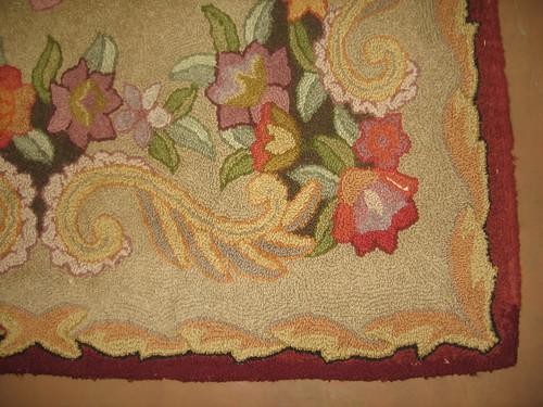SOLD: Hooked rug r corner