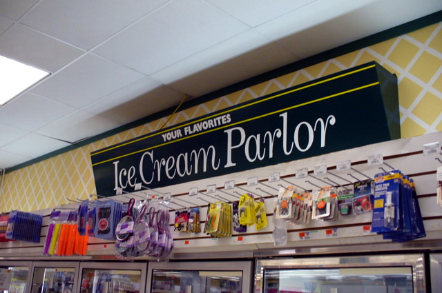 Ice cream parlor department sign.
