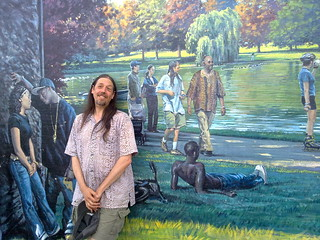 Neil Alexander next to a mural of himself in Newburgh!