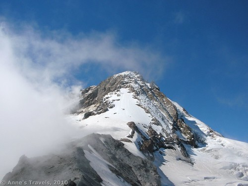 Clouds swirl away from Cooper Spur and Mt. Hood's summit, Oregon