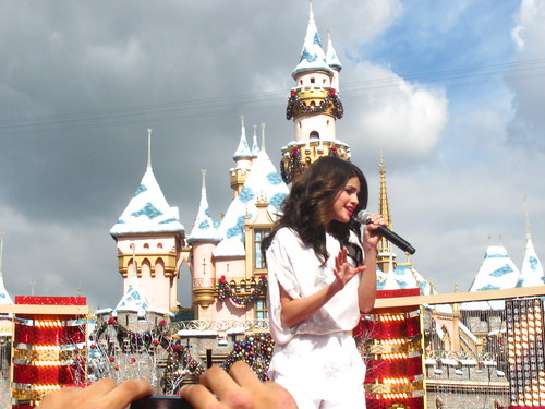 Selena Gomez performs in front of Sleeping Beauty Castle by Loren Javier