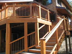 Cedar, tigerwood deck with copper ballusters overlooking Lake Sammamish