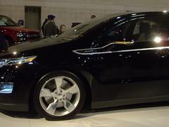 concept car(0.0), automobile(1.0), automotive exterior(1.0), family car(1.0), wheel(1.0), vehicle(1.0), automotive design(1.0), rim(1.0), auto show(1.0), chevrolet volt(1.0), land vehicle(1.0), electric vehicle(1.0),