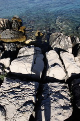 long shadow on the rocks