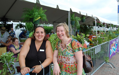 WWOZ volunteer Stacey and New Orleans-Helsinki Connection trombonist Katja Toivola chat at the WWOZ Hospitality Tent.