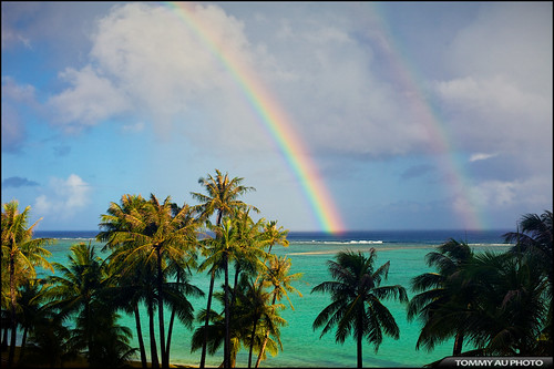 ocean blue clouds rainbow palmtrees rainbows guam tumon tamuning